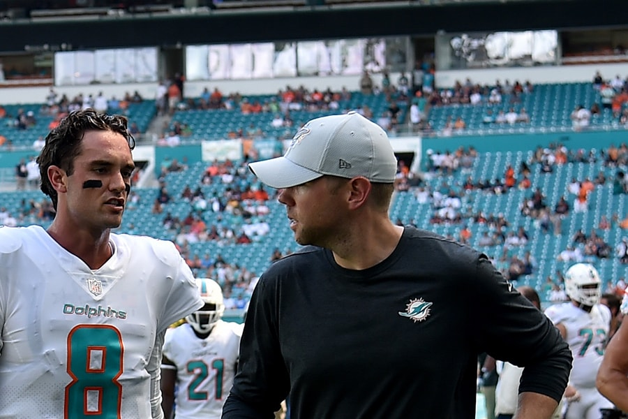 The Patriots are expected to add Bo Hardegree (right) to the coaching staff. Here he is pictured talking with former Dolphins quarterback Brock Osweiler. (Steve Mitchell-USA TODAY)