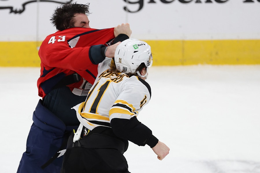 Capitals head coach Peter Laviolette didn't seem happy about Tom Wilson deciding to fight Trent Frederic. (Geoff Burke-USA TODAY)