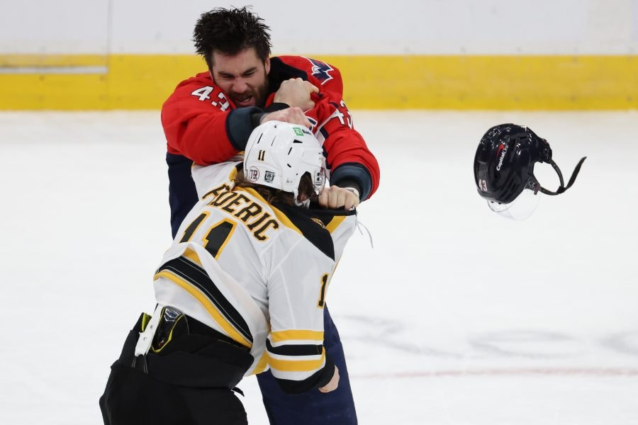 Feb 1, 2021; Washington, District of Columbia, USA; Washington Capitals right wing Tom Wilson (43) fights Boston Bruins center Trent Frederic (11) in the third period at Capital One Arena. Mandatory Credit: Geoff Burke-USA TODAY Sports