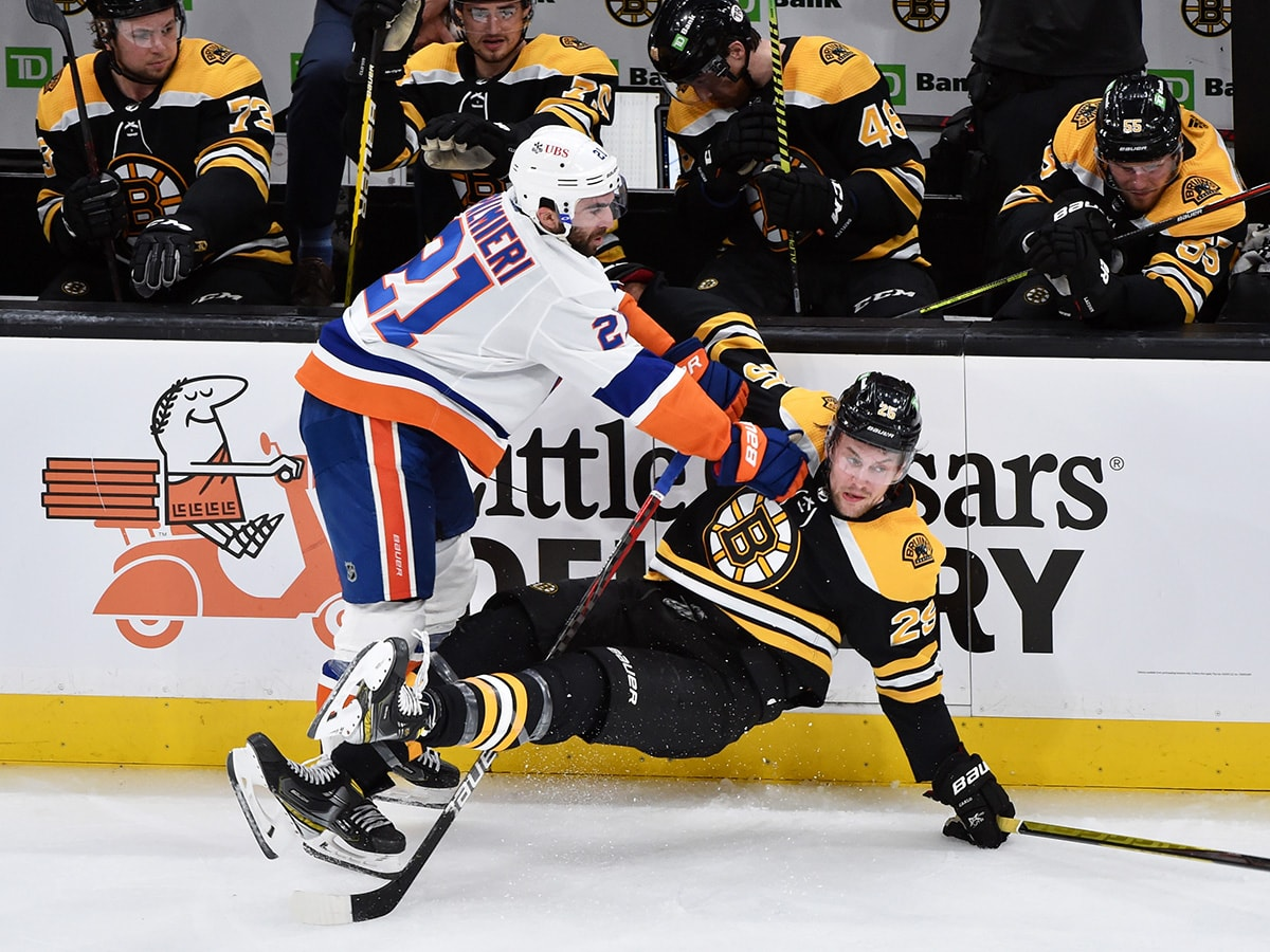 May 29, 2021; Boston, MA, USA; New York Islanders right wing Kyle Palmieri (21) checks Boston Bruins defenseman Brandon Carlo (25) during the second period in game one of the second round of the 2021 Stanley Cup Playoffs at TD Garden. Mandatory Credit: Bob DeChiara-USA TODAY Sports