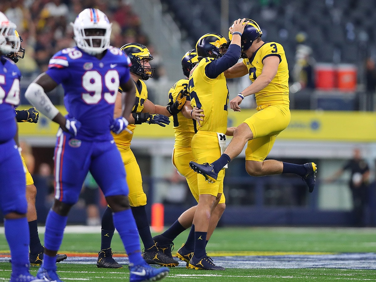 ARLINGTON, TX - SEPTEMBER 02: Garrett Moores #15 of the Michigan Wolverines and Quinn Nordin #3 of the Michigan Wolverines celebrate a successful field goal in the first half of a game at AT&T Stadium on September 2, 2017 in Arlington, Texas. (Photo by Tom Pennington/Getty Images)