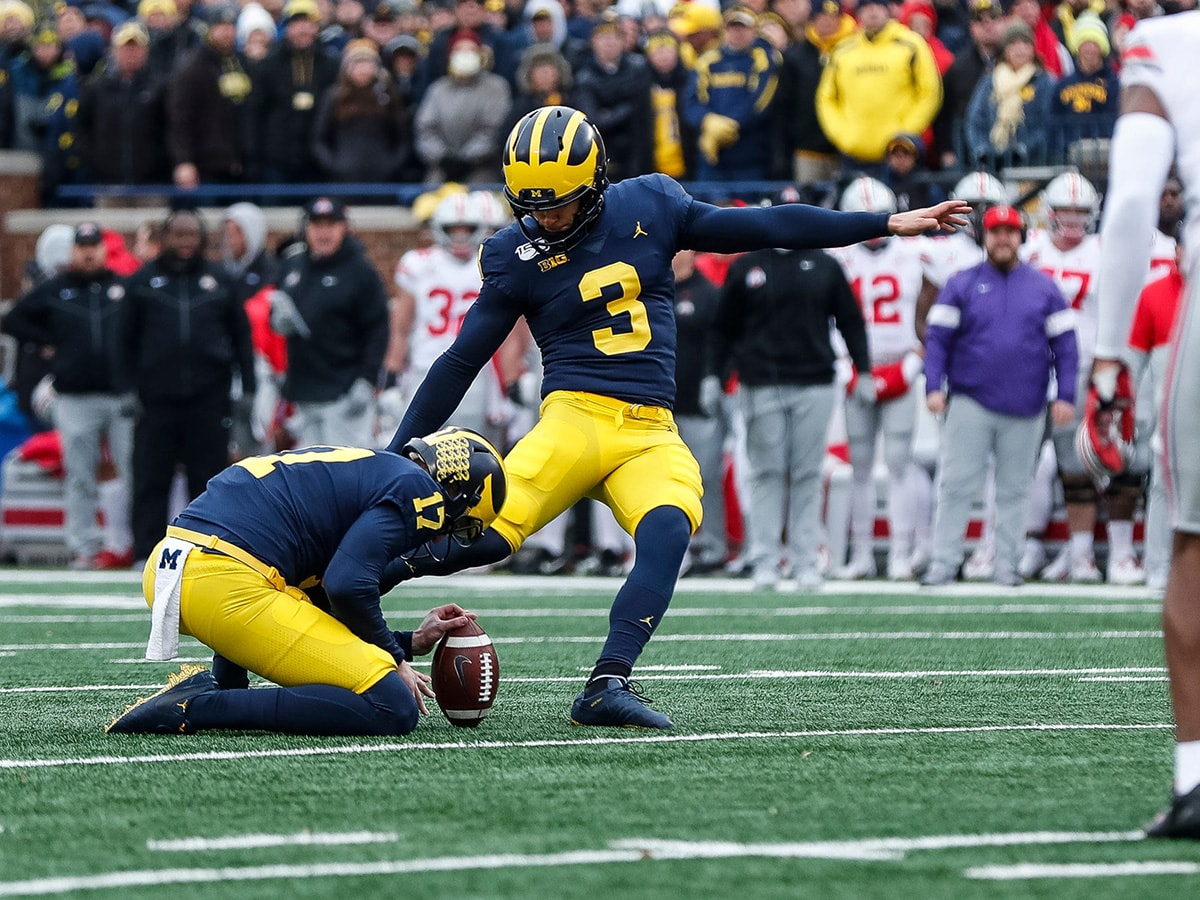 Michigan place kicker Quinn Nordin attempts for an extra point against Ohio State during the first half at the Michigan Stadium in Ann Arbor, Saturday, Nov. 30, 2019.