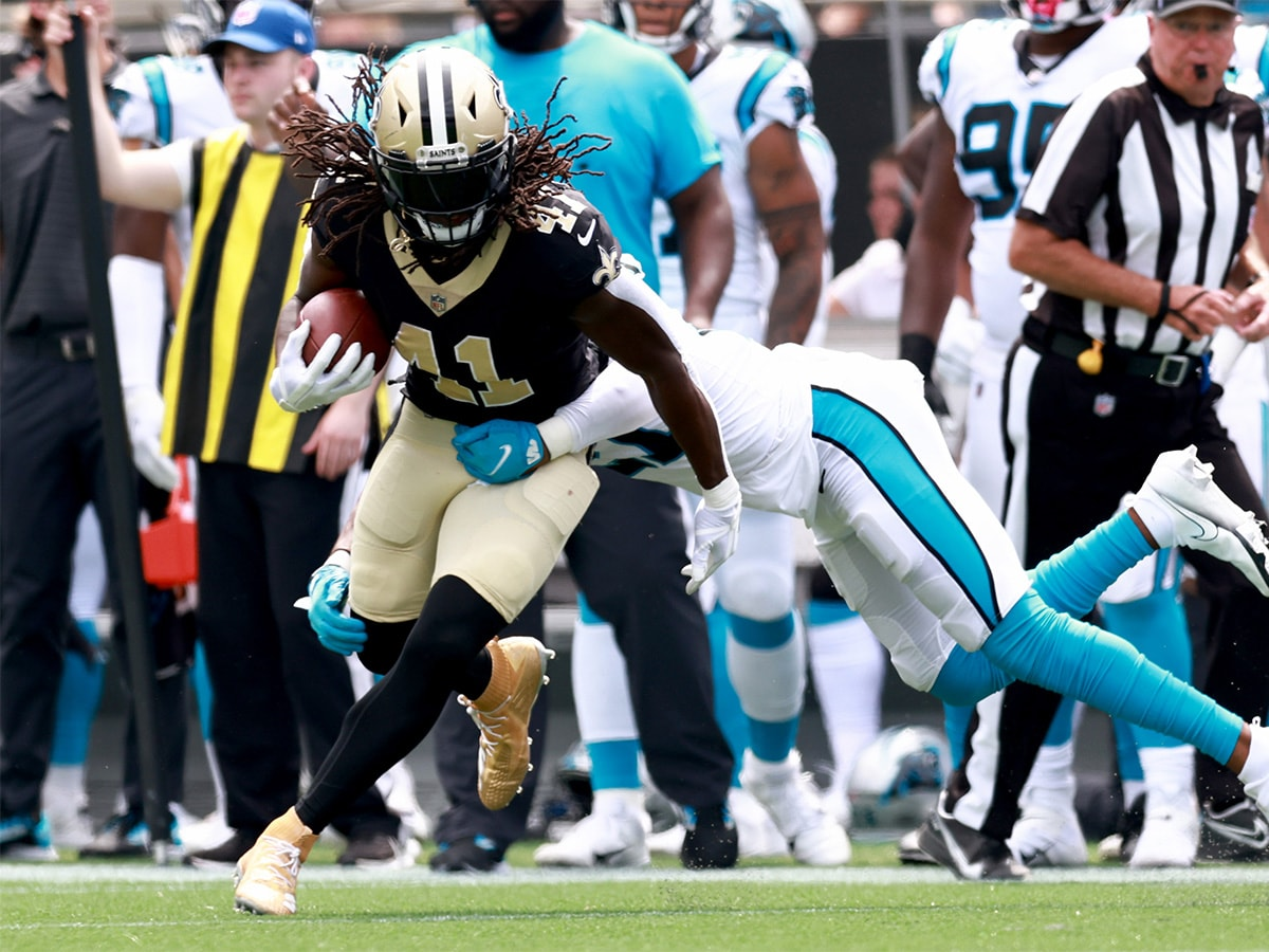 CHARLOTTE, NORTH CAROLINA - SEPTEMBER 19: Running back Alvin Kamara #41 of the New Orleans Saints runs the ball during the first half in the game against the Carolina Panthers at Bank of America Stadium on September 19, 2021 in Charlotte, North Carolina. (Photo by Grant Halverson/Getty Images)