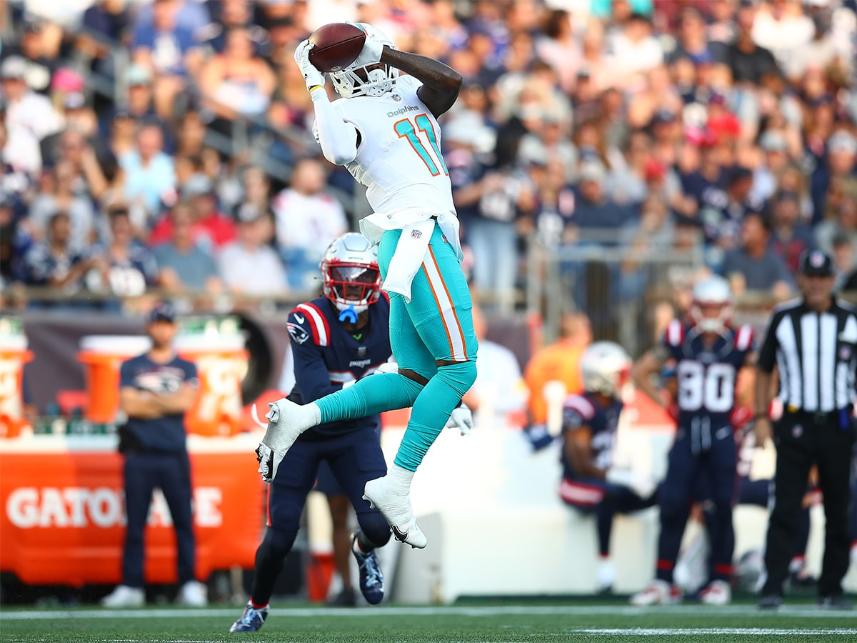 FOXBOROUGH, MASSACHUSETTS - SEPTEMBER 12: DeVante Parker #11 of the Miami Dolphins makes a reception against the New England Patriots during the first half at Gillette Stadium on September 12, 2021 in Foxborough, Massachusetts. (Photo by Adam Glanzman/Getty Images)