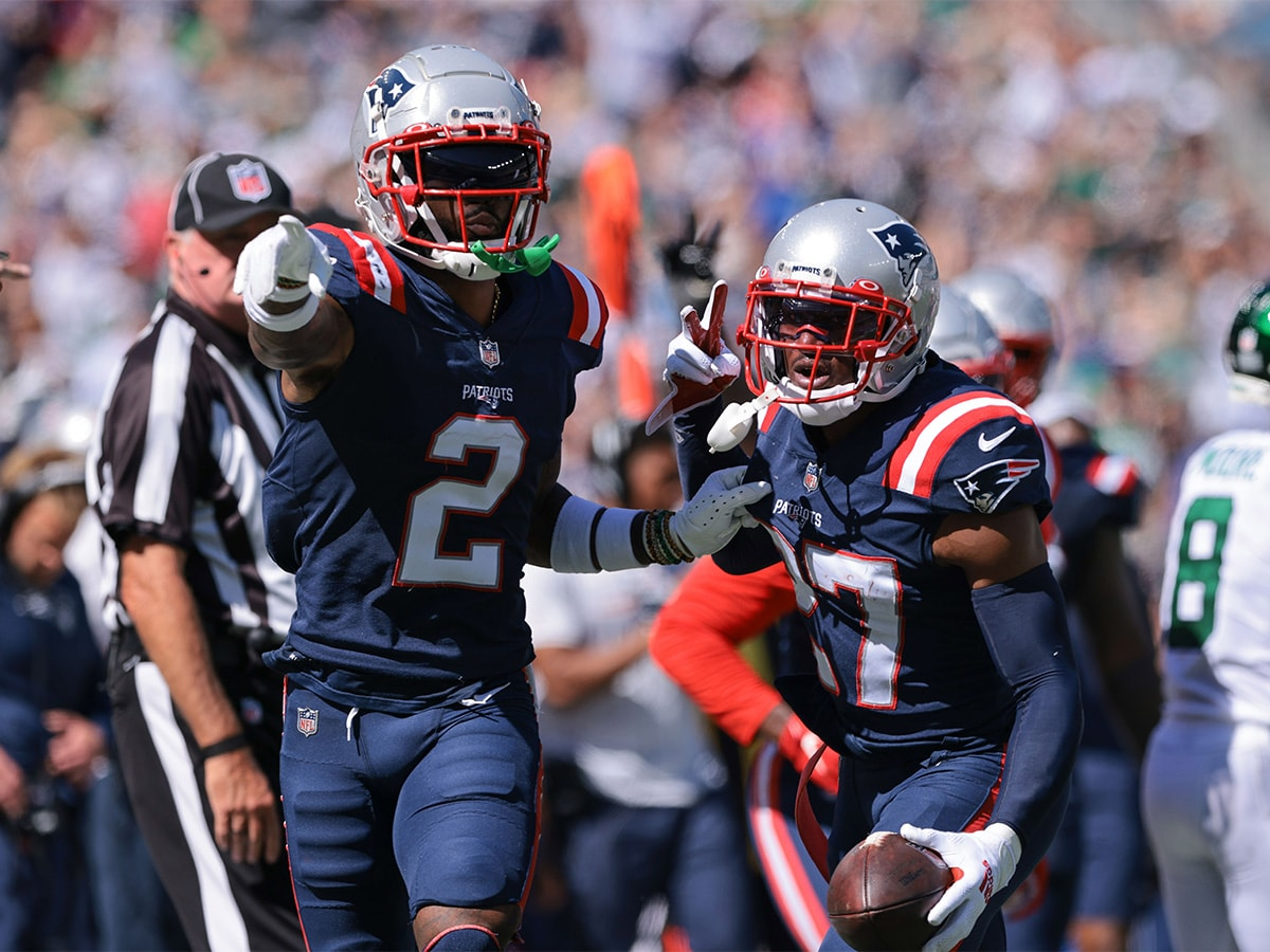 Sep 19, 2021; East Rutherford, New Jersey, USA; New England Patriots defensive back J.C. Jackson (27) celebrates his interception with cornerback Jalen Mills (2) during the first half against the New York Jets at MetLife Stadium. Mandatory Credit: Vincent Carchietta-USA TODAY Sports