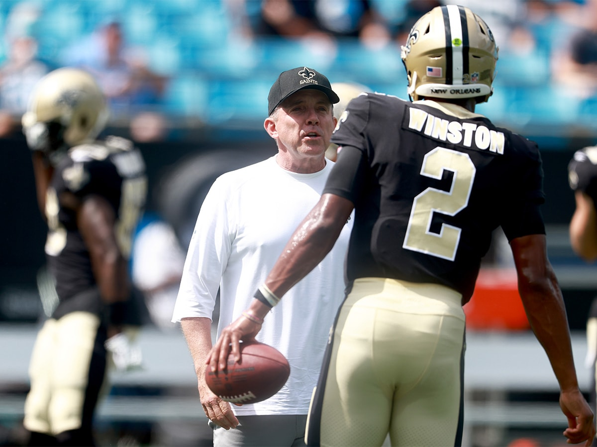 CHARLOTTE, NORTH CAROLINA - SEPTEMBER 19: Quarterback Jameis Winston #2 of the New Orleans Saints talks with head coach Sean Payton before the game against the Carolina Panthers at Bank of America Stadium on September 19, 2021 in Charlotte, North Carolina. (Photo by Grant Halverson/Getty Images)