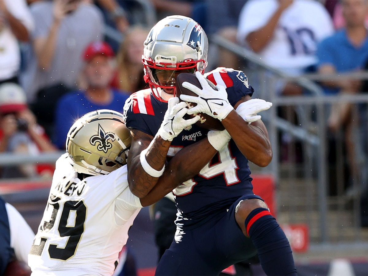 FOXBOROUGH, MASSACHUSETTS - SEPTEMBER 26: Kendrick Bourne #84 of the New England Patriots makes the catch and runs it in for a touchdown as Paulson Adebo #29 of the New Orleans Saints defends in the fourth quarter at Gillette Stadium on September 26, 2021 in Foxborough, Massachusetts. The New Orleans Saints beat the New England Patriots 28-13. (Photo by Elsa/Getty Images)