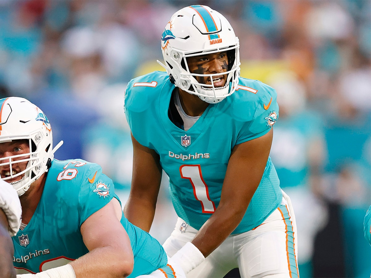 MIAMI GARDENS, FLORIDA - AUGUST 21: Tua Tagovailoa #1 of the Miami Dolphins looks on under center Michael Deiter #63 against the Atlanta Falcons during a preseason game at Hard Rock Stadium on August 21, 2021 in Miami Gardens, Florida. (Photo by Michael Reaves/Getty Images)