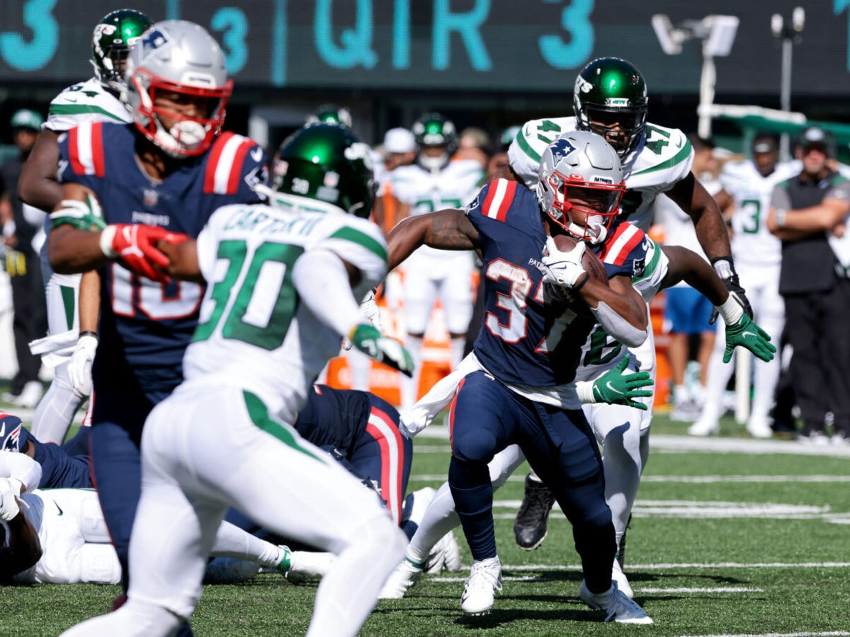 Sep 19, 2021; East Rutherford, New Jersey, USA; New England Patriots running back Damien Harris (37) carries the ball as New York Jets defensive end Bryce Huff (47) pursues during the second half at MetLife Stadium. Mandatory Credit: Vincent Carchietta-USA TODAY Sports
