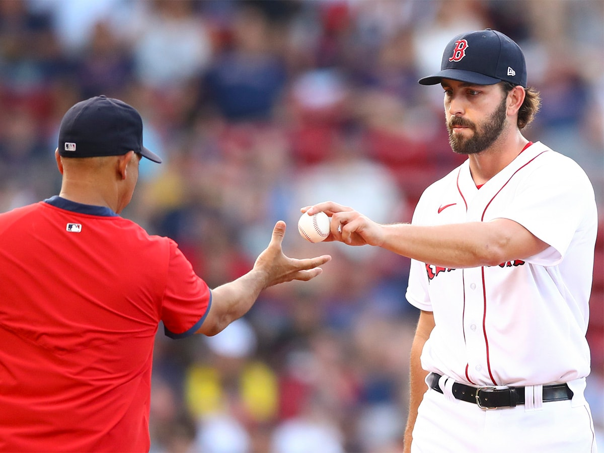 BOSTON, MA - AUGUST 12: Austin Davis #65 of the Boston Red Sox is pulled from the game in the eighth inning against the Tampa Bay Rays at Fenway Park on August 12, 2021 in Boston, Massachusetts. (Photo by Adam Glanzman/Getty Images)