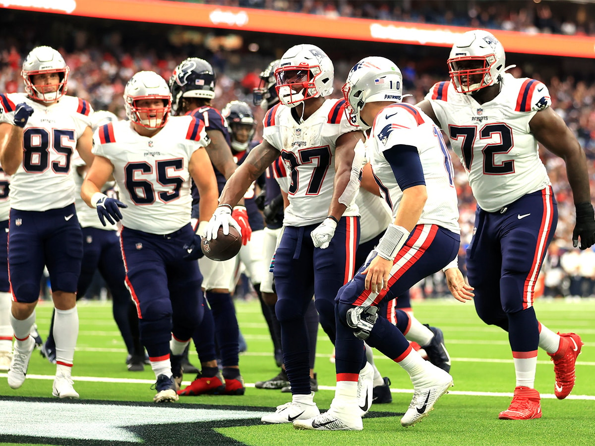 HOUSTON, TEXAS - OCTOBER 10: Damien Harris #37 of the New England Patriots celebrates a touchdown during the first half against the Houston Texans at NRG Stadium on October 10, 2021 in Houston, Texas. (Photo by Carmen Mandato/Getty Images)