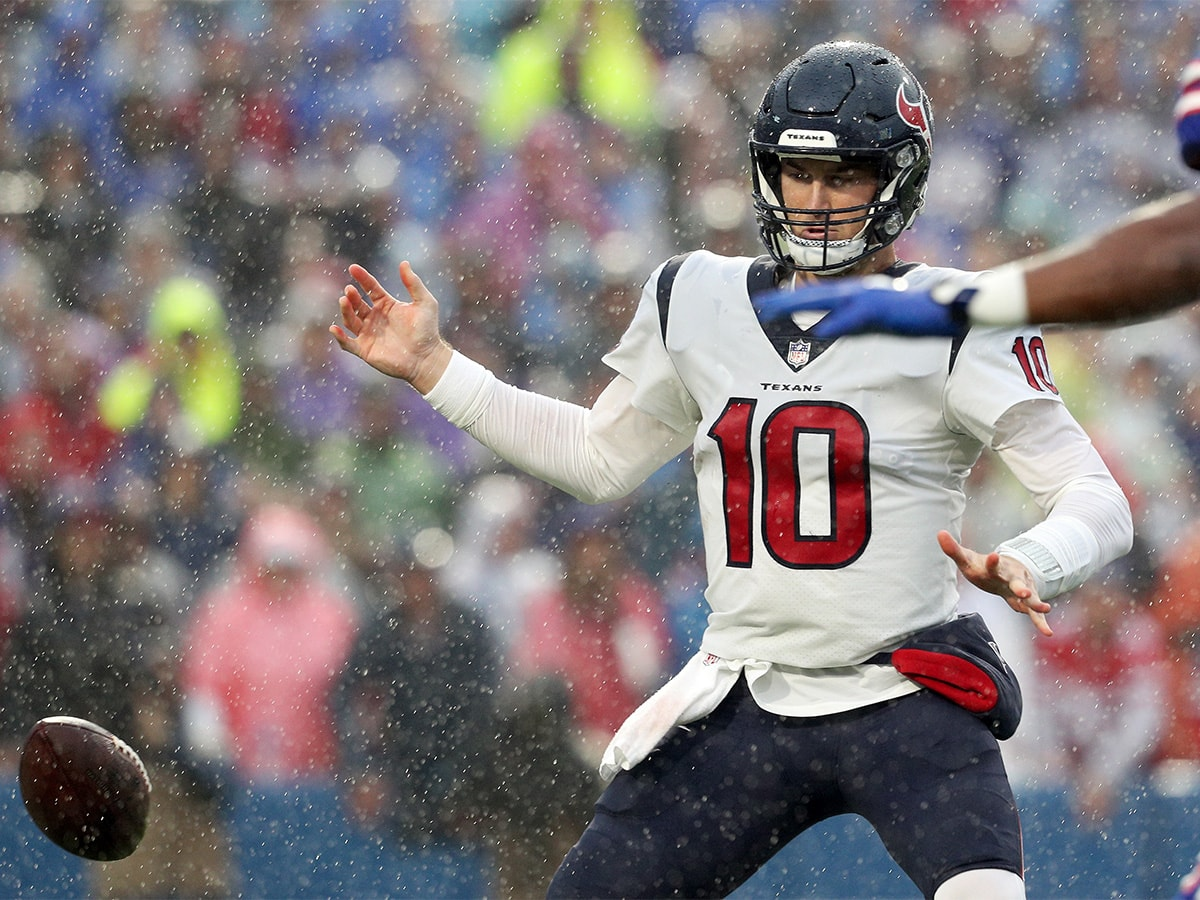 ORCHARD PARK, NEW YORK - OCTOBER 03: Quarterback Davis Mills #10 of the Houston Texans fumbles the ball against the Buffalo Bills in first quarter at Highmark Stadium on October 03, 2021 in Orchard Park, New York. (Photo by Bryan M. Bennett/Getty Images)