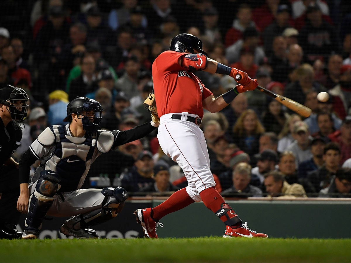 Oct 5, 2021; Boston, Massachusetts, USA; Boston Red Sox designated hitter Kyle Schwarber (18) hits a solo home run against the New York Yankees during the third inning of the American League Wildcard game at Fenway Park. Mandatory Credit: Bob DeChiara-USA TODAY Sports