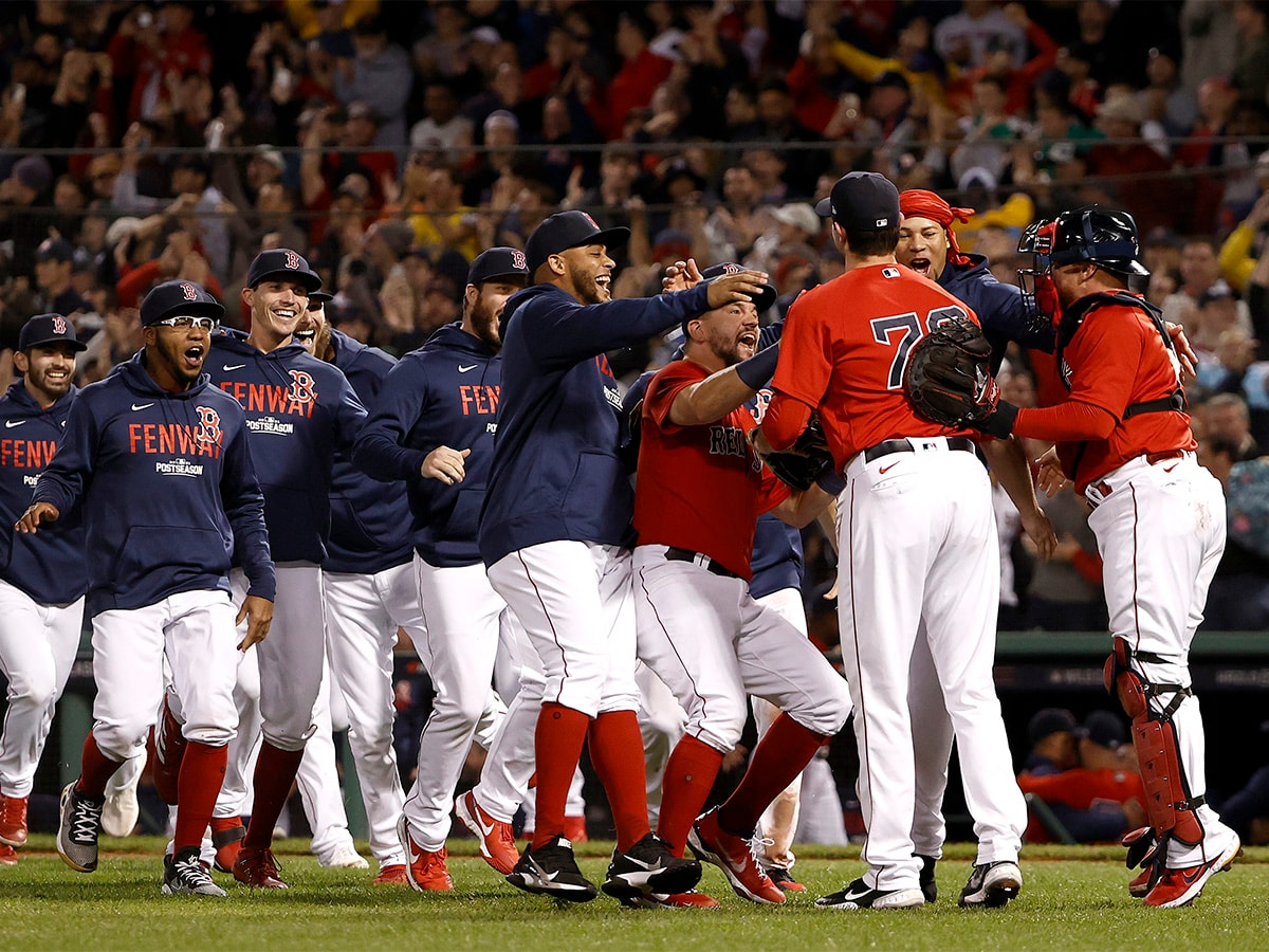 BOSTON, MASSACHUSETTS - OCTOBER 05: The Boston Red Sox run to Garrett Whitlock #72 as they celebrate their 6-2 win against the New York Yankees in the American League Wild Card game at Fenway Park on October 05, 2021 in Boston, Massachusetts. (Photo by Winslow Townson/Getty Images)